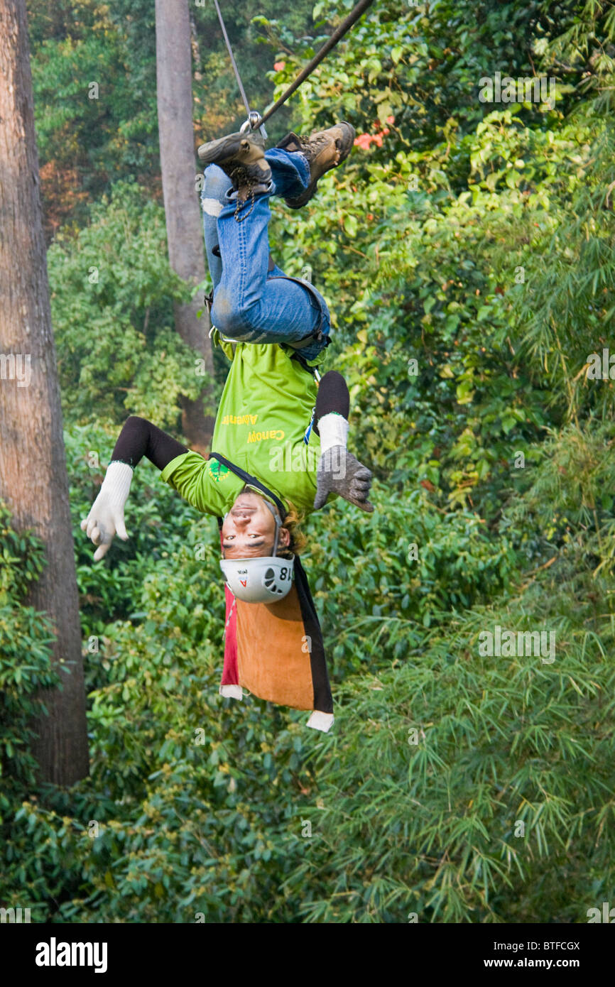 'Flying' upside down on ziplines at canopy tour in the Chiang Mai area of Thailand - Stock Image