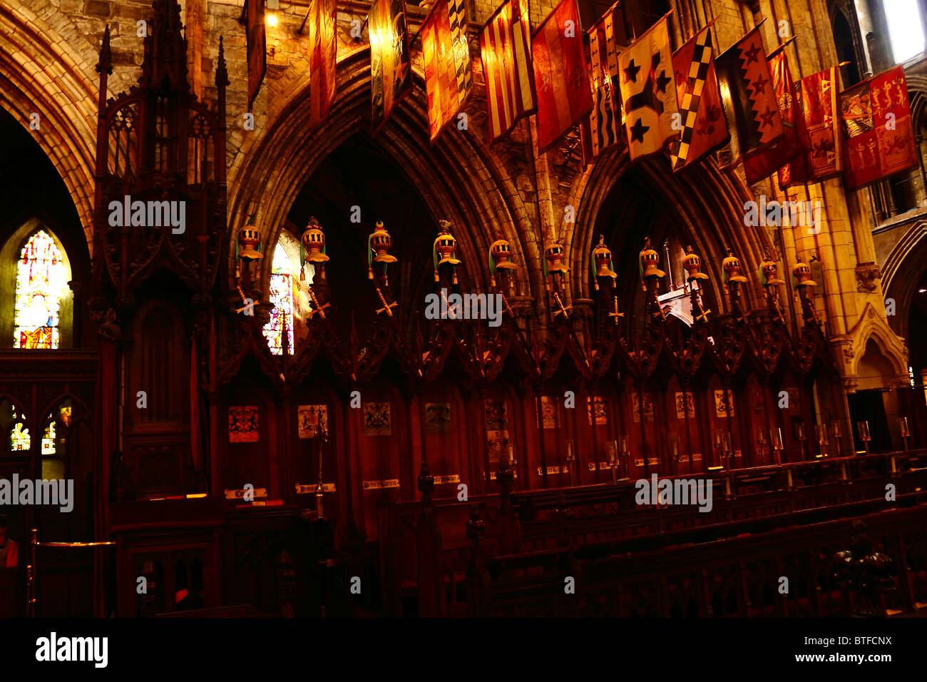 Banners and coats of arms of the knights displayed in the Choir of the Saint Patrick's Cathedral in Dublin, - Stock Image