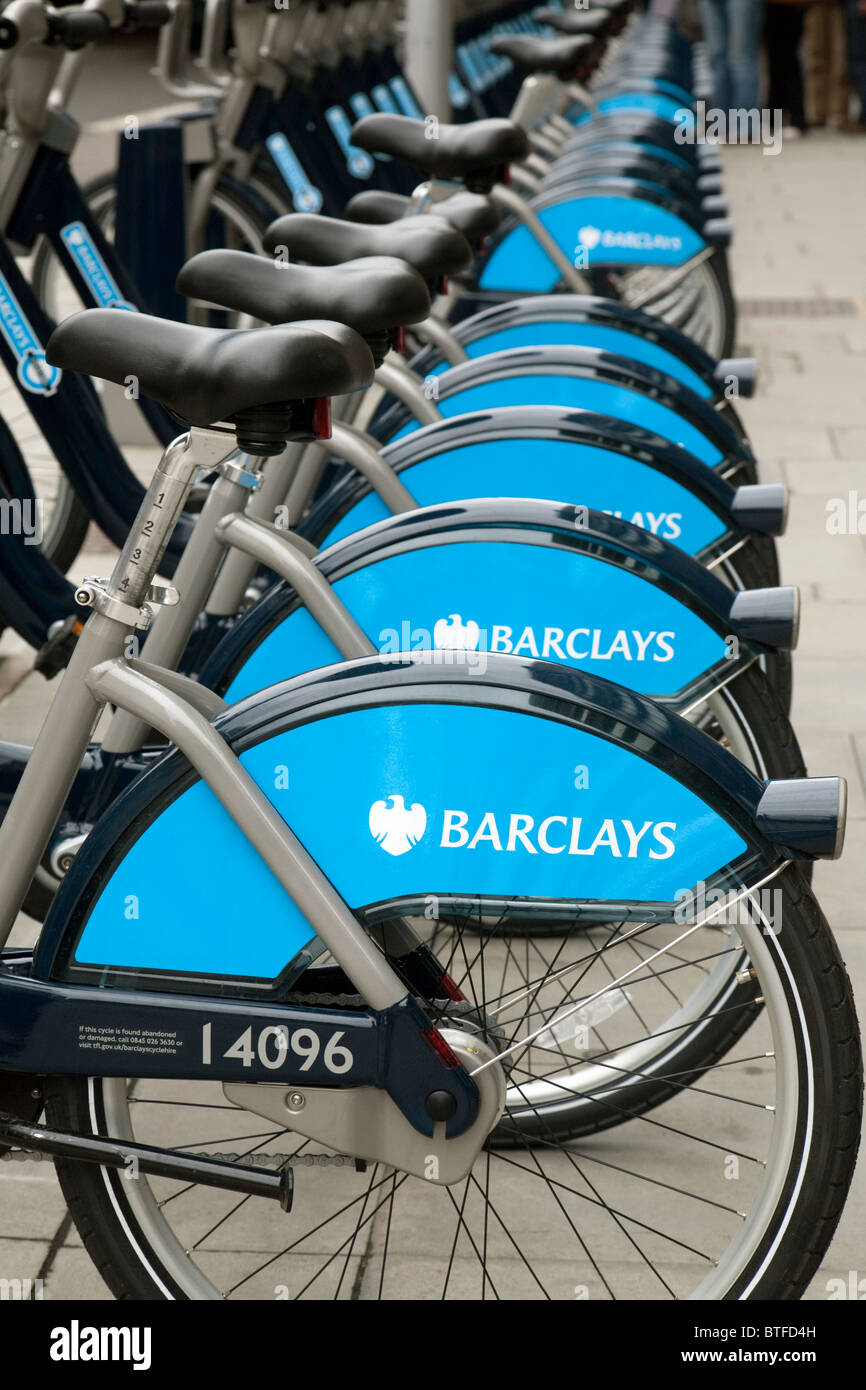 Barclays Transport for London Cycling scheme cycles in a bicycle rack for hire, Southwark Rd, London UK - Stock Image