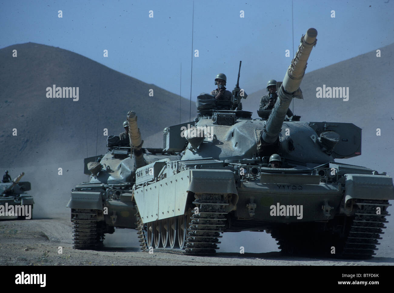 Iranian Army tanks on manoeuvres in  the desert in early 1970s during the regime of the Shah of Iran Stock Photo