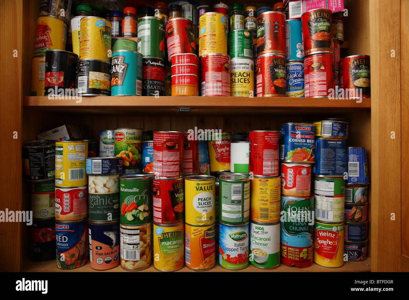 over stocked food cupboard - Stock Image