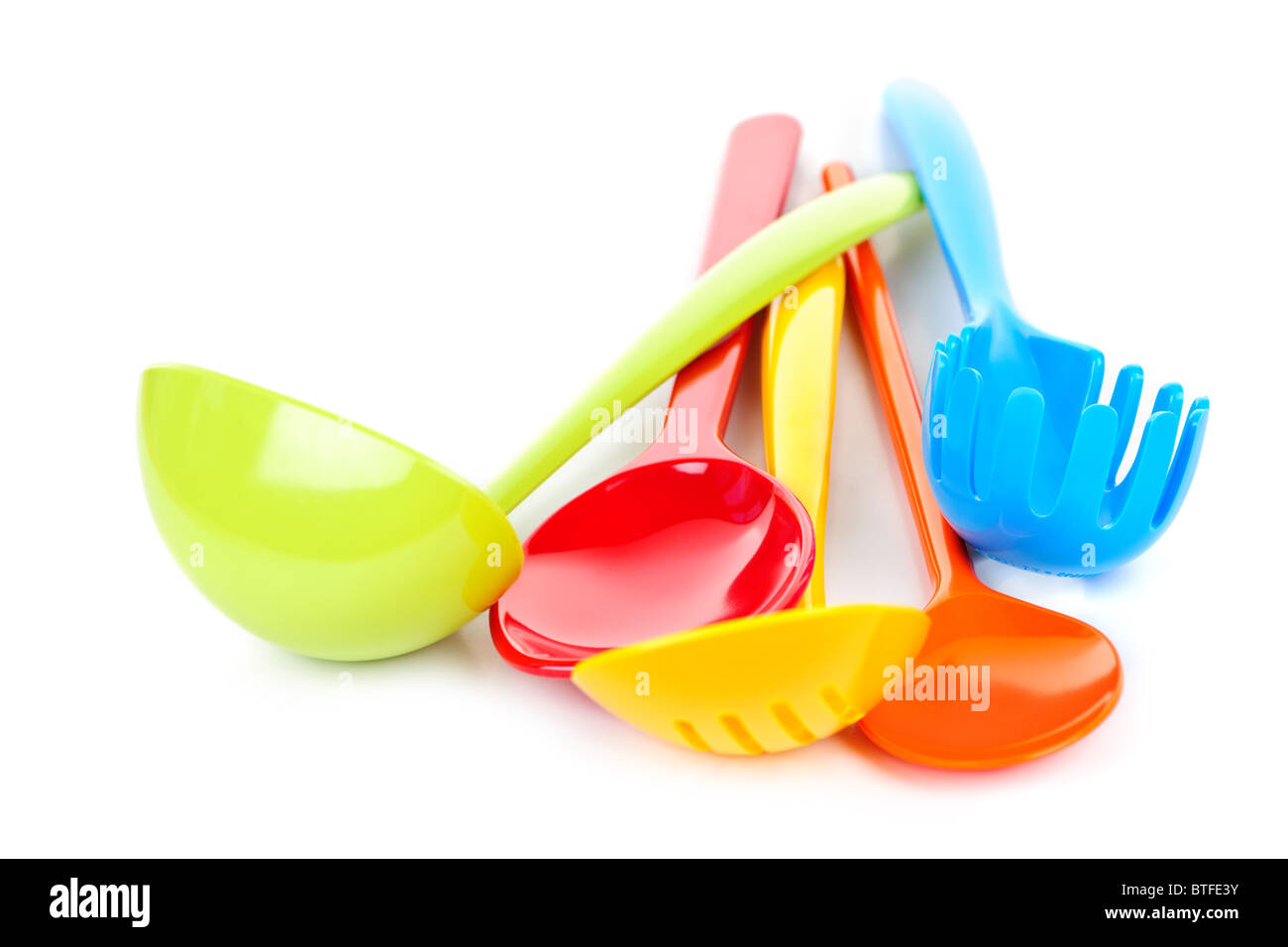 Various Colorful Plastic Kitchen Utensils On White Background