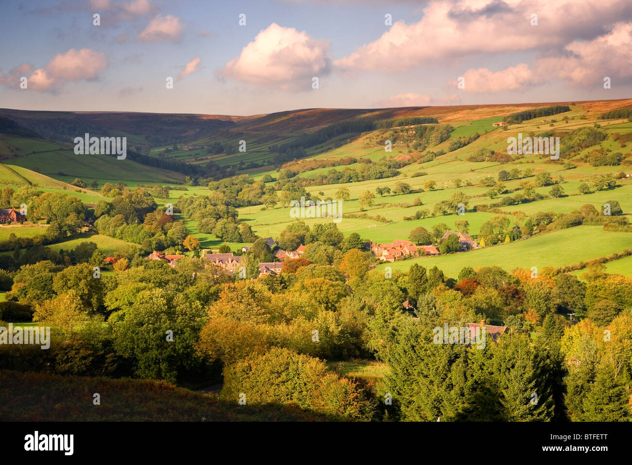 Warm sunlight illuminating The North York Moors Village of Rosedale and surrounding countryside, North Yorkshire, - Stock Image