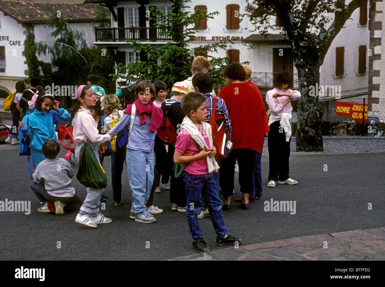 French Basque people boys girls children schoolchildren students on student field trip in town of Saint-Jean-Pied - Stock Image