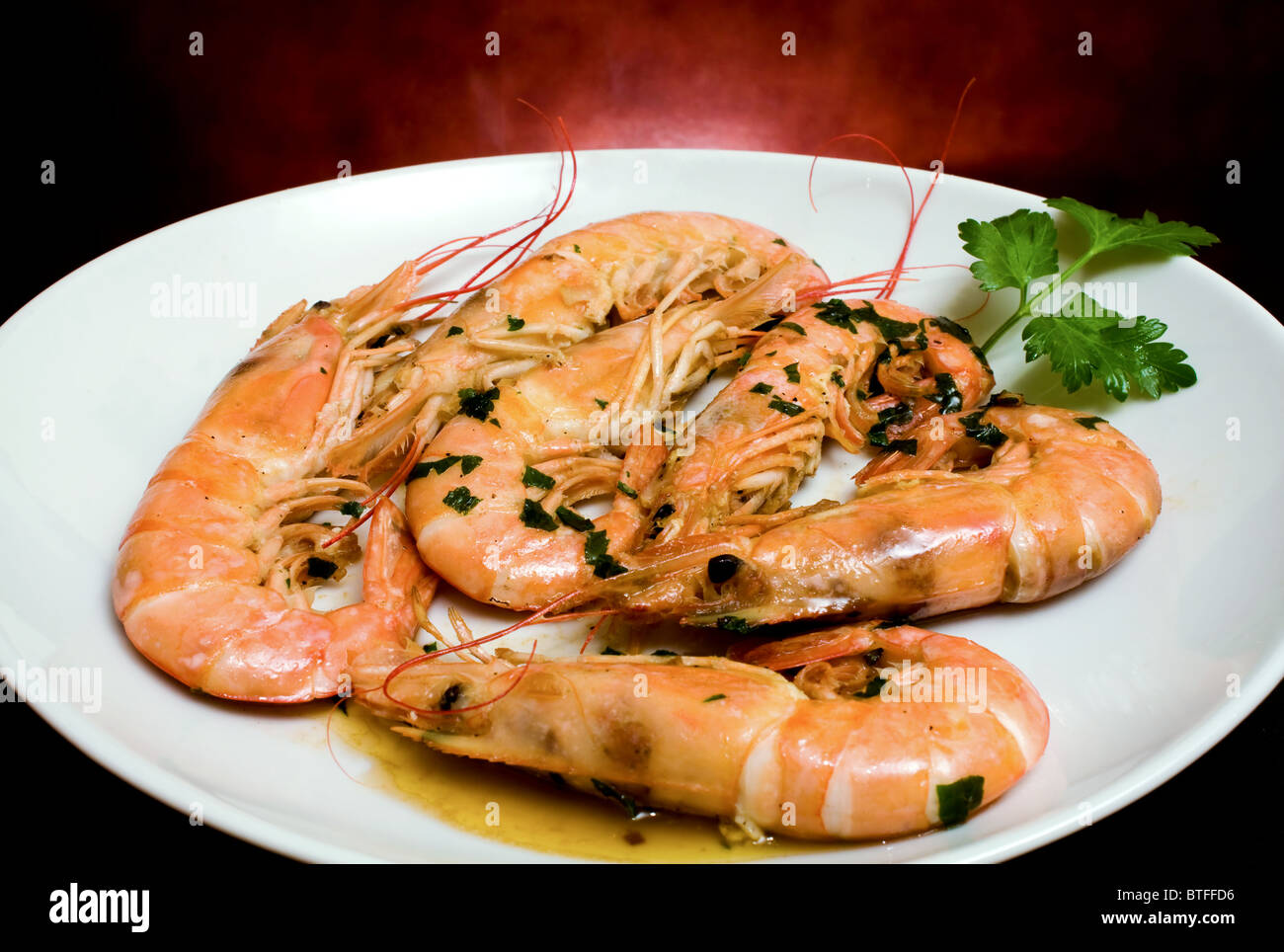 italian traditional christmas dinner food prawns with garlic and parsley stock image - Traditional Italian Christmas Dinner