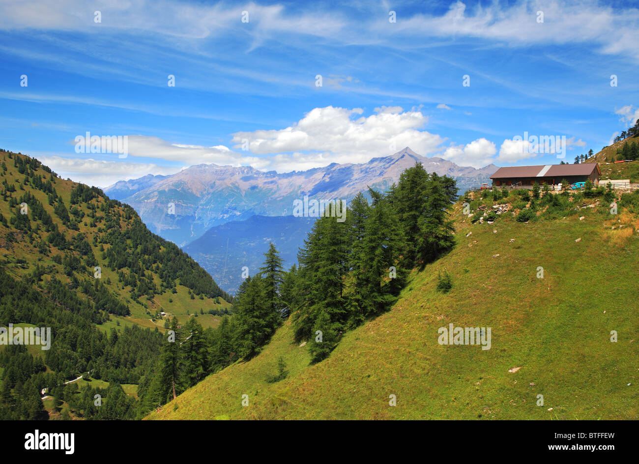 View on hills and peaks of Alps in northern Italy. - Stock Image