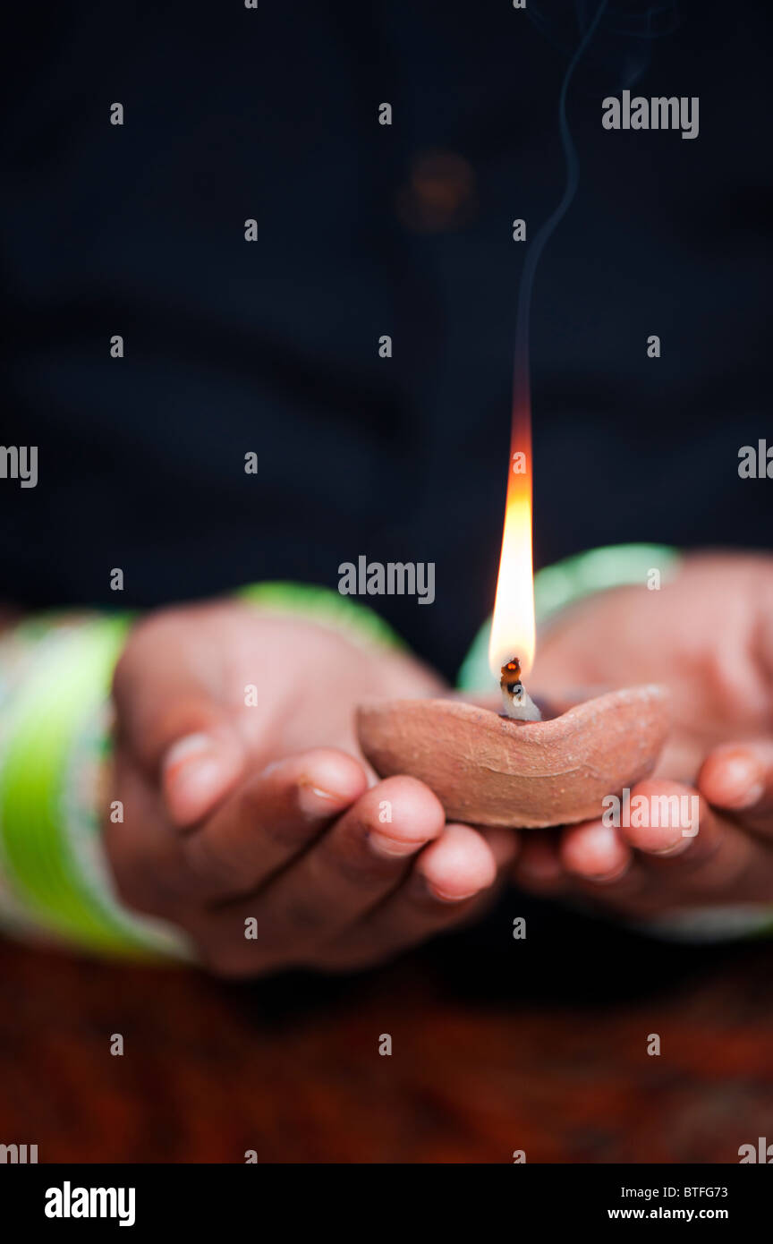Young Indian girl holding a lit oil lamp. India Stock Photo ... for Girl Holding Lamp  303mzq