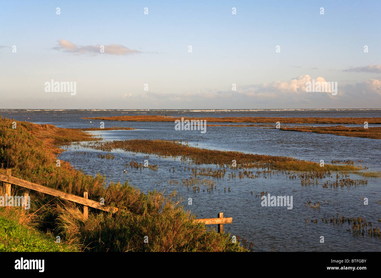 The harbour channel at high tide in early morning light at Thornham, Norfolk, England, United Kingdom. Stock Photo