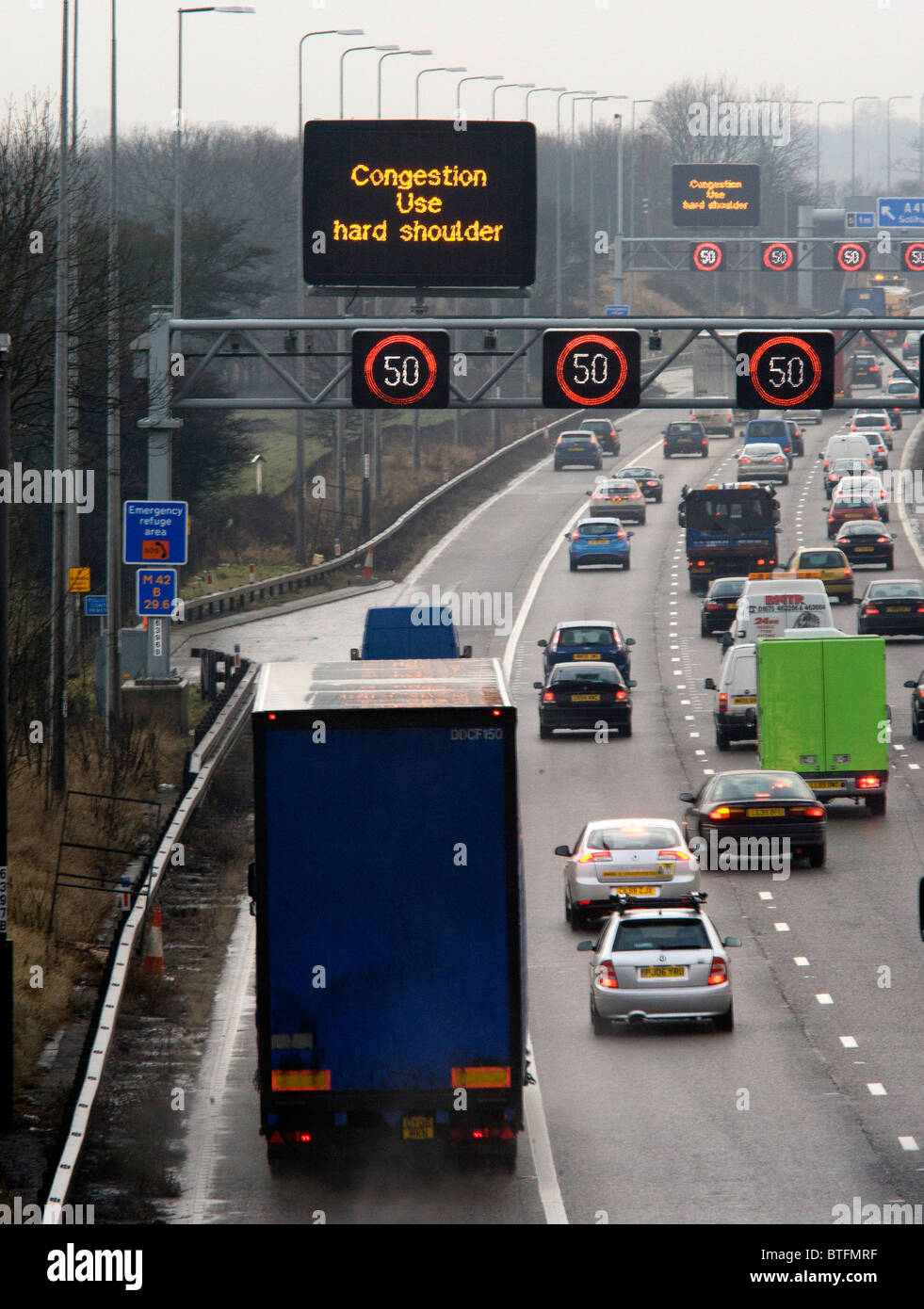 Signage on the M42 motorway in the West Midlands advising motorists to use the hard shoulder when there is congestion - Stock Image