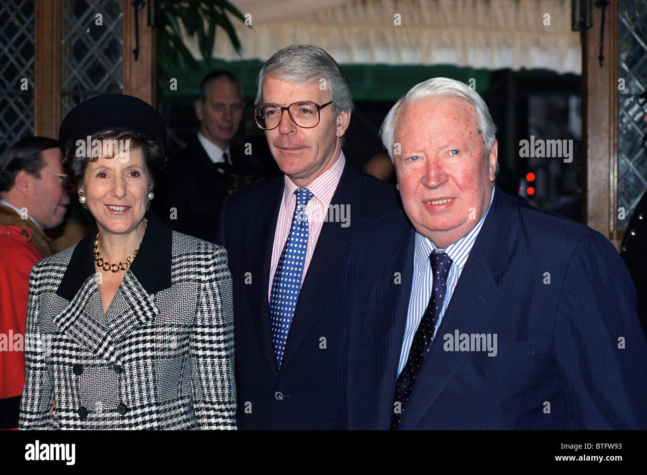 FORMER PRIME MINISTER JOHN MAJOR AND WIFE NORMA WITH TED HEATH (FORMER PRIME MINISTER) AT THE GUILDHALL, LONDON - Stock Image