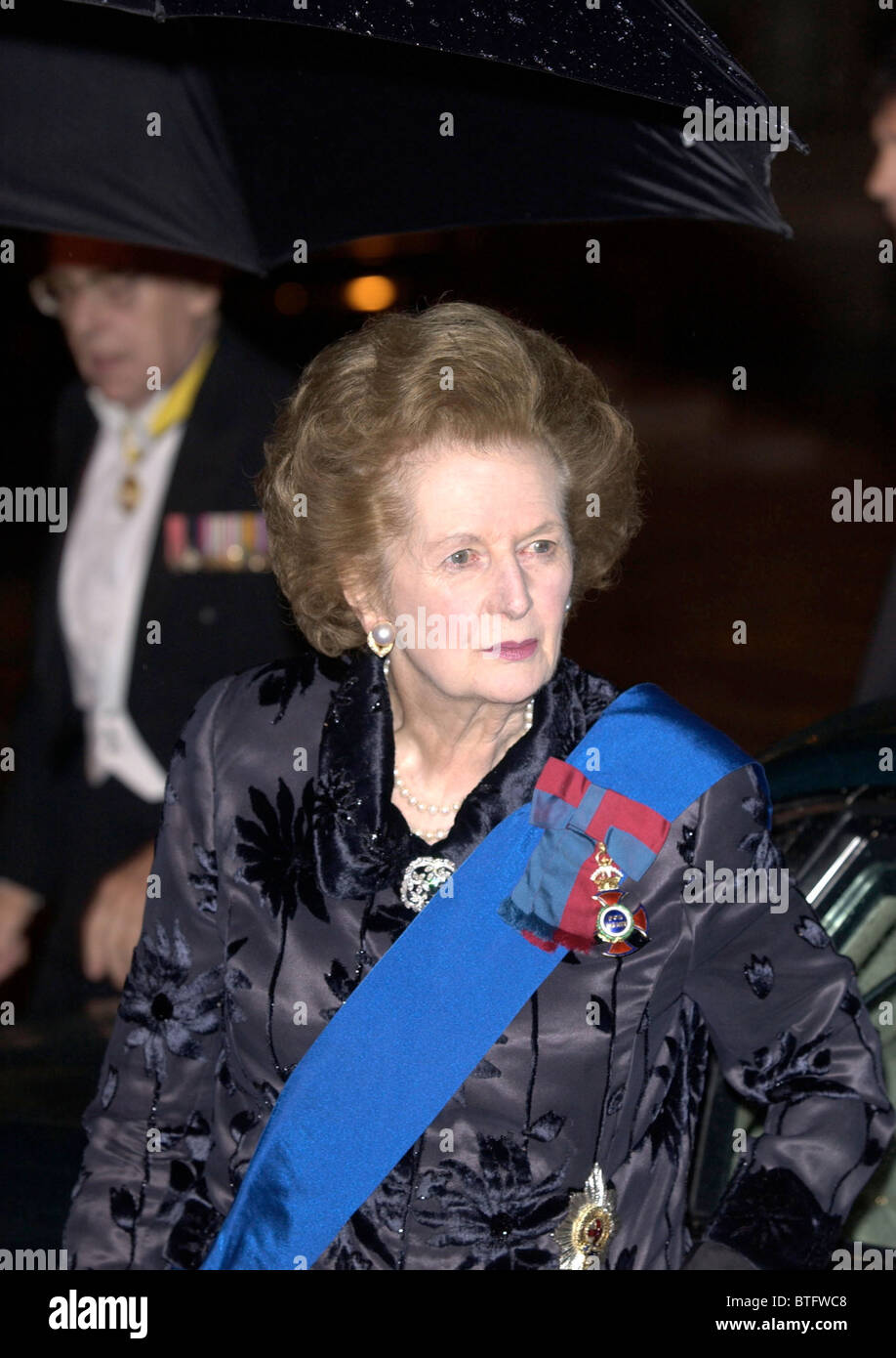 BARONESS MARGARET THATCHER [ FORMER PRIME MINISTER ] WITH DECORATIONS AND SASH AT BANQUET AT THE GUILDHALL IN LONDON - Stock Image