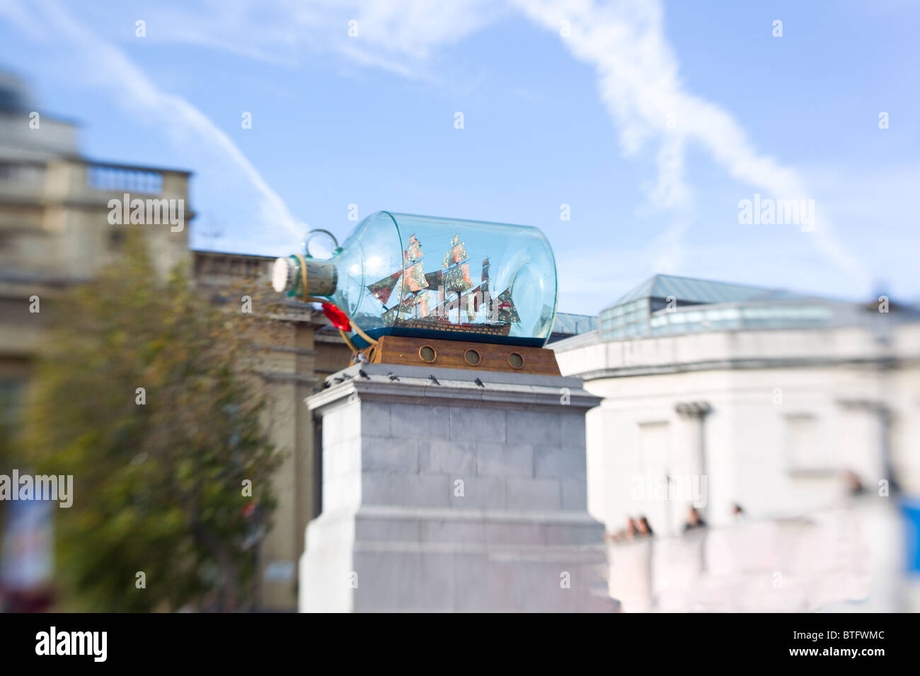 Large Ship In A Bottle Display on the spare fourth plinth in Trafalgar Square London England - Stock Image
