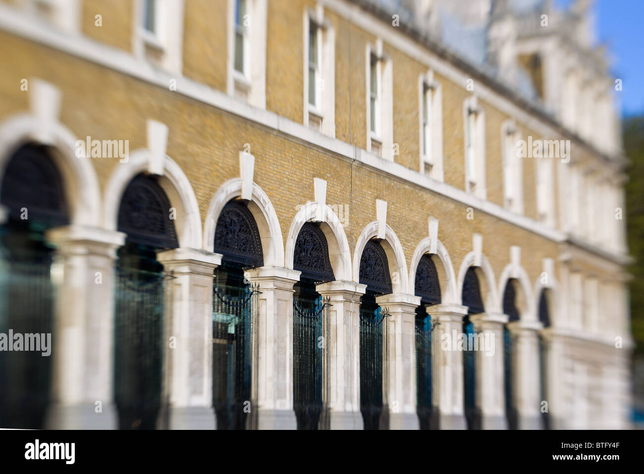 Wrought Iron Gates Against Brickwork Of Old Victoria Building London England - Selective Focus Image - Stock Image