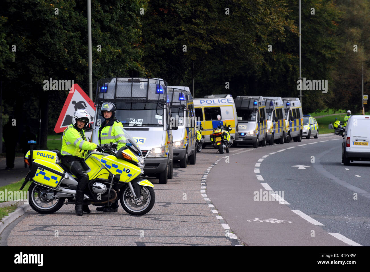 Police line up their vans as they get ready for a protest march in Brighton by SMASH EDO - Stock Image