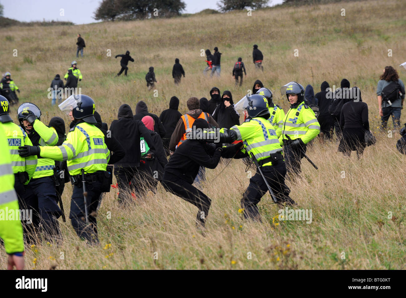 Police officers in riot gear clash with protesters during a recent Smash EDO march held in Brighton - Stock Image