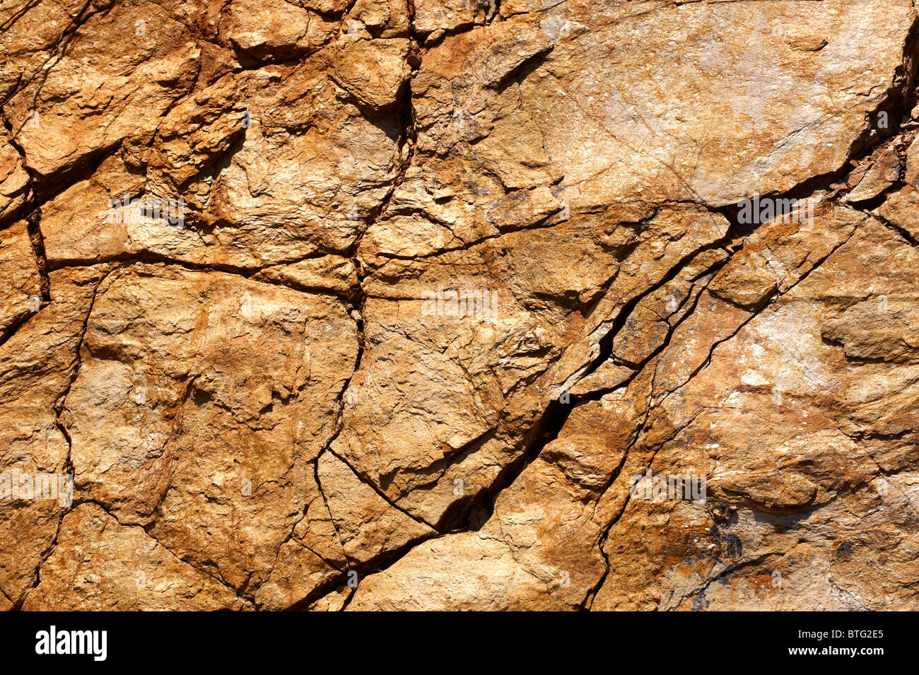 close up textures and layers of Sandstone schists on the Island of Ios, Cyclades Islands, Greece - Stock Image