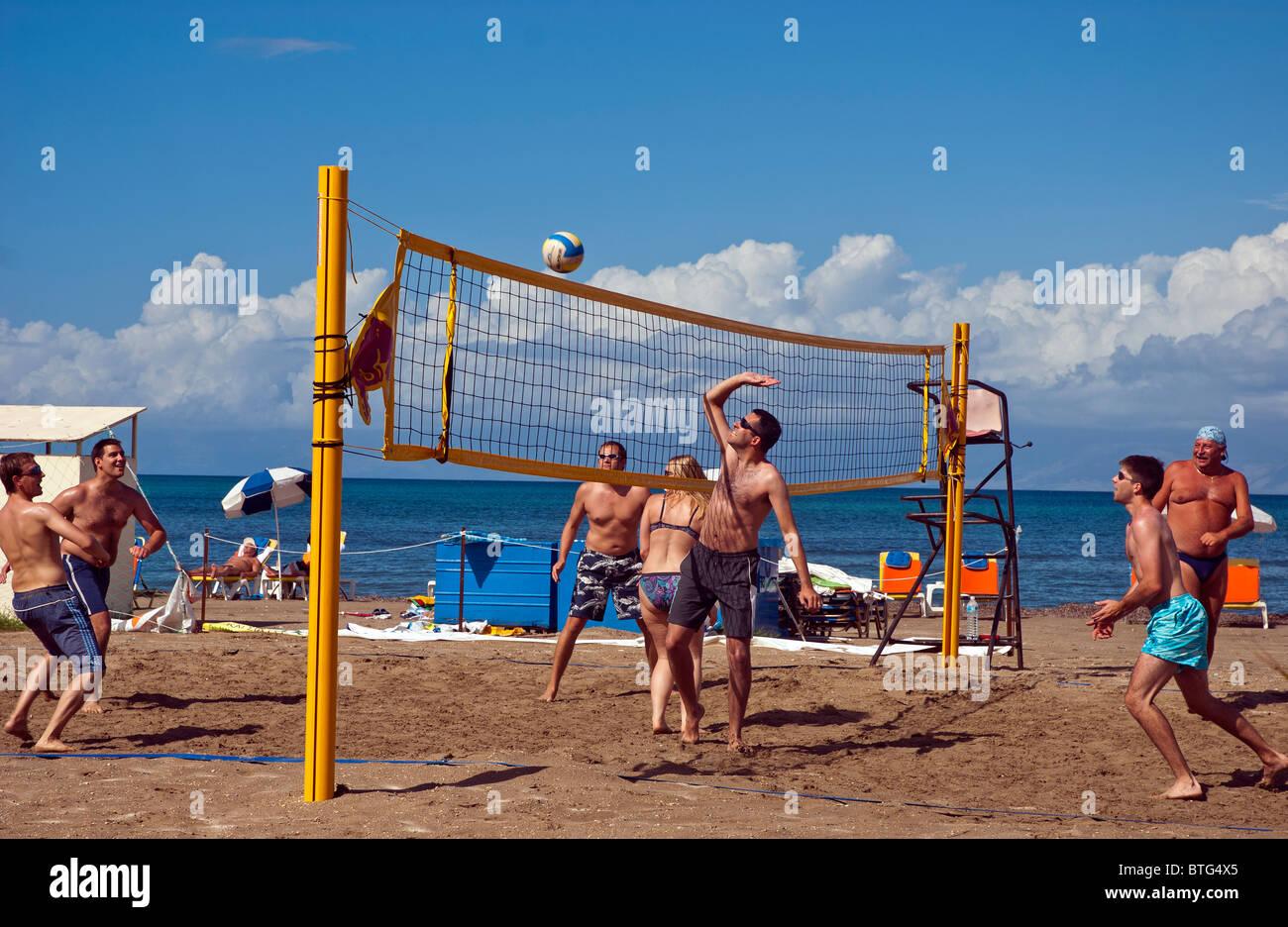 Volleyball players at  Roda Beach, Corfu, Ionian Islands Greece. - Stock Image