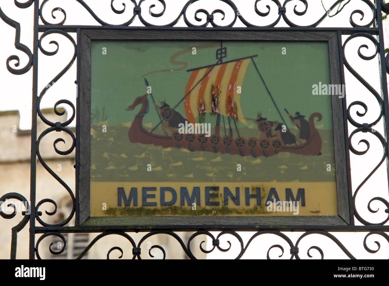 Medmenham, Buckinghamshire, England - the village sign outside the church Stock Photo