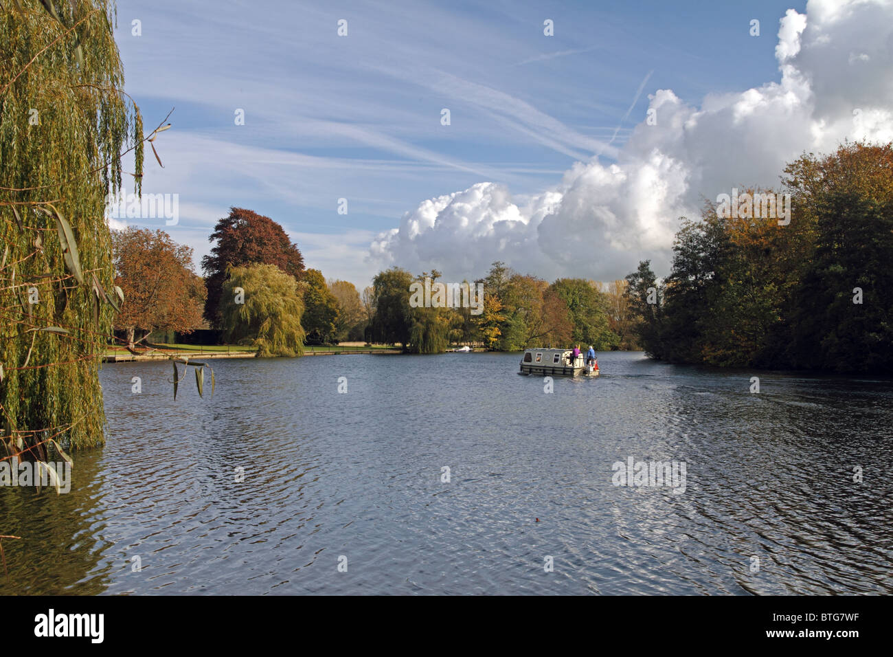A river cruiser on the river Thames at Mednemham, Berkshire, England Stock Photo