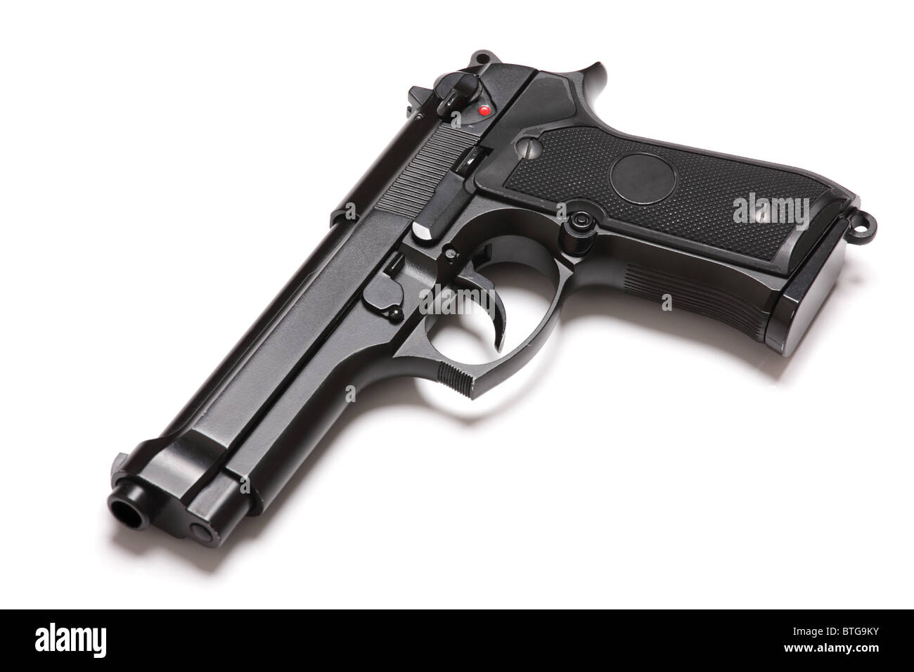 U.S. Army modern handgun M9 close-up. Isolated on a white background. Tilt view. Studio shot. Weapon series. - Stock Image