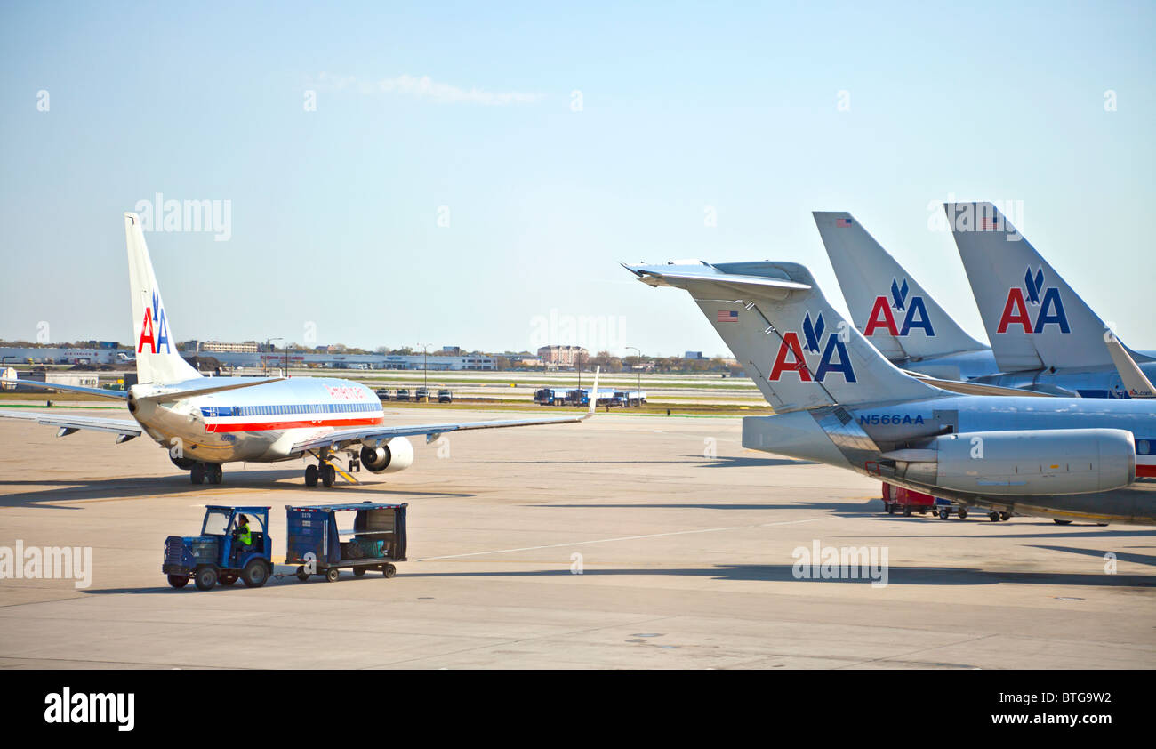 Four American Airlines jet airliners at Chicago O'Hare Airport, Illinois, USA - Stock Image