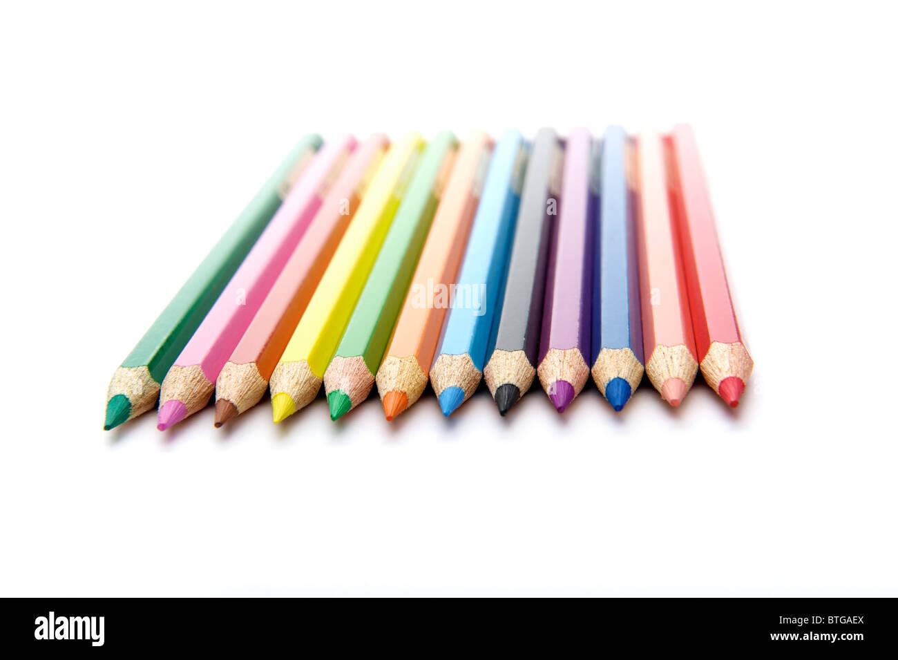 horizontal row of twelve colored pencils Stock Photo