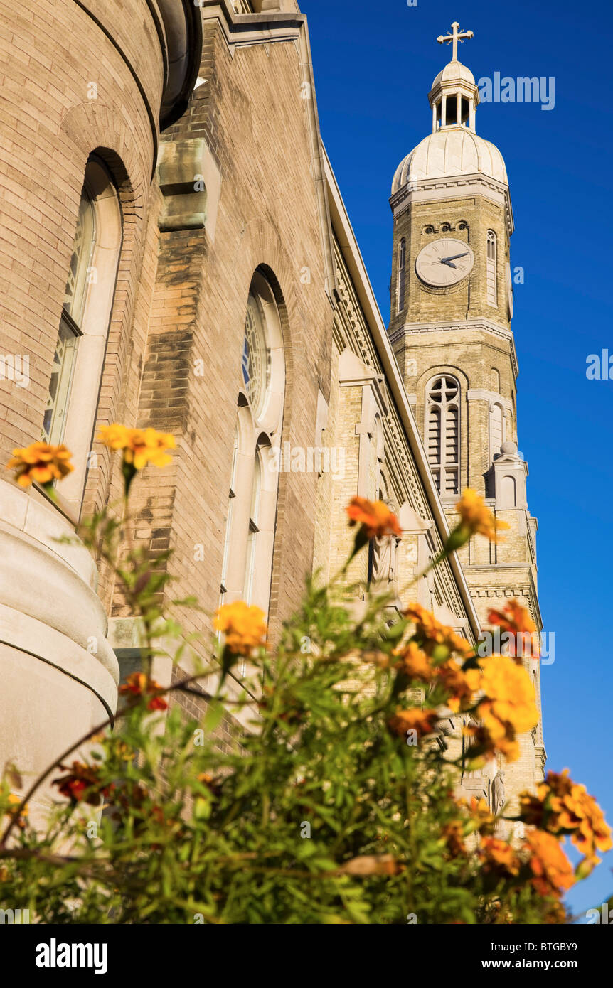 Flowers in front of St Stanislaus Catholic Church in Milwaukee - Stock Image