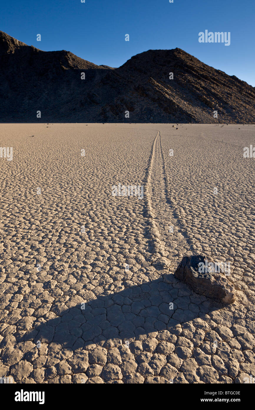 Sailing stones or sliding rocks mysteriously move across The Racetrack Playa in Death Valley National Park, California - Stock Image