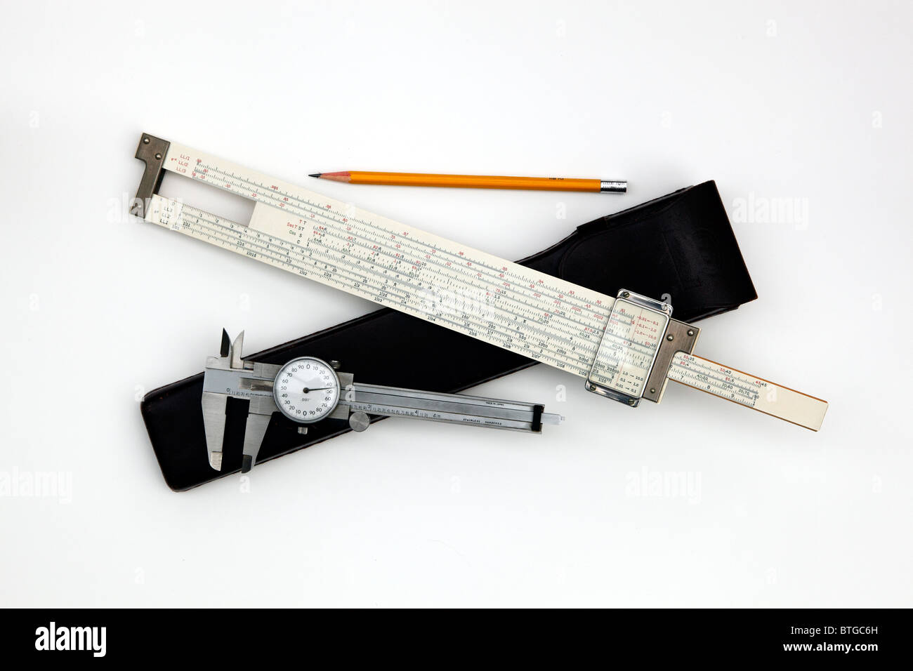 A slide rule, dial caliper and pencil were the pre-computer tools of the trade for many engineers. - Stock Image