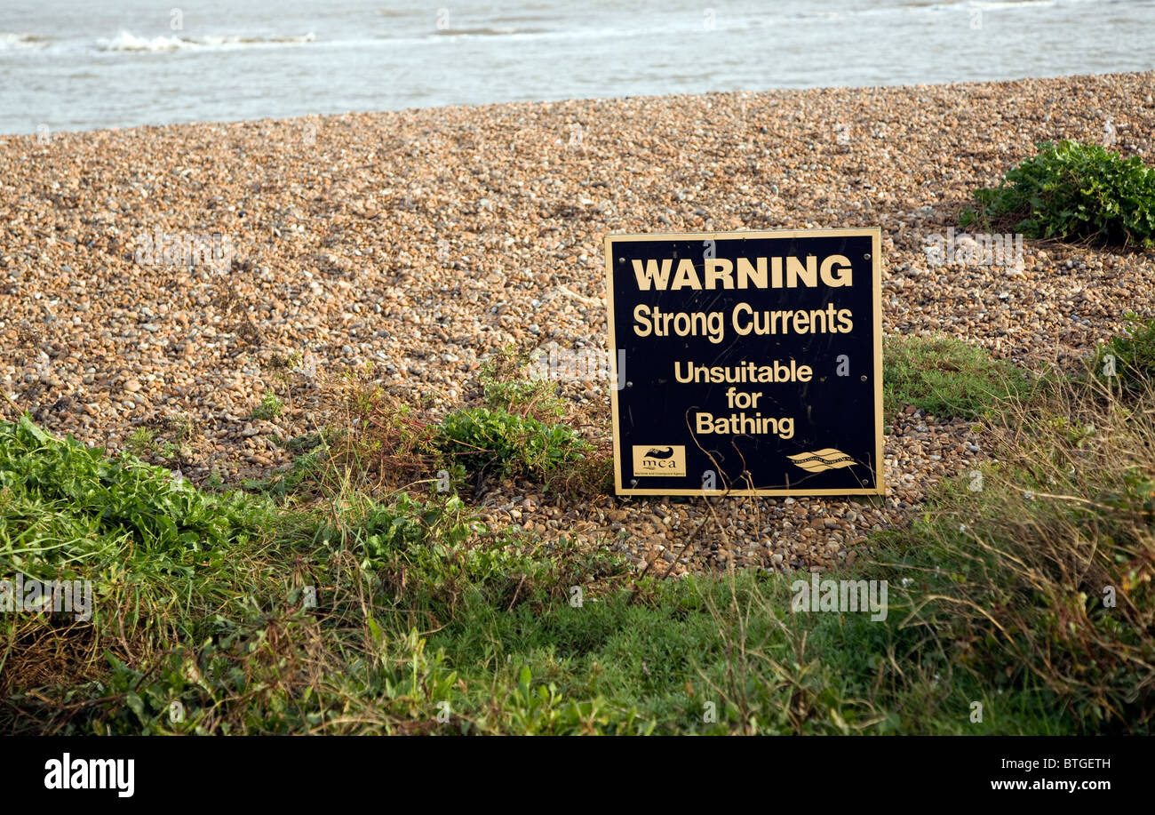 Sign Warning strong currents unsuitable for bathing Shingle Street Suffolk - Stock Image