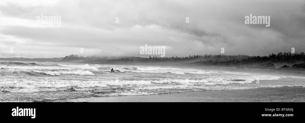 Lone surfer, Long Beach, Wickanninsh Bay, British Columbia Canada Stock Photo