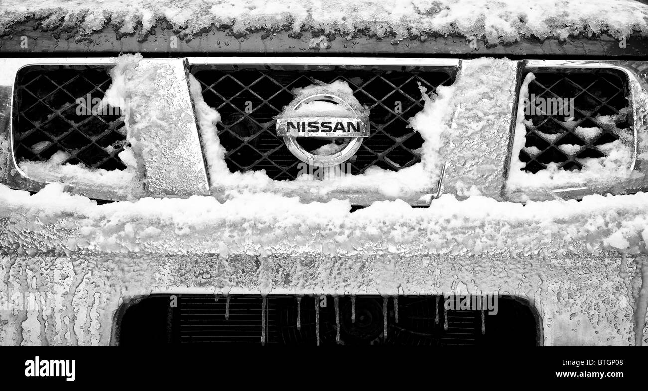Frozen snow and ice on the front of a Nissan Pathfinder Stock Photo