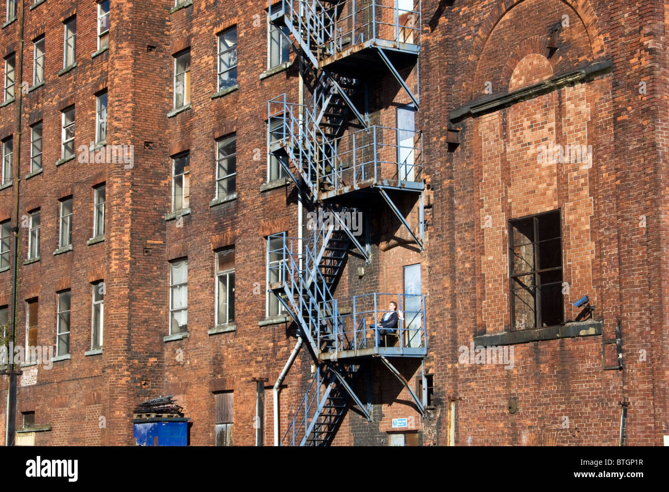 Fire escape tea break, Oxford Mills, adjacent to Ashton Canal, Ashton under Lyne, Tameside, Greater Manchester, Stock Photo