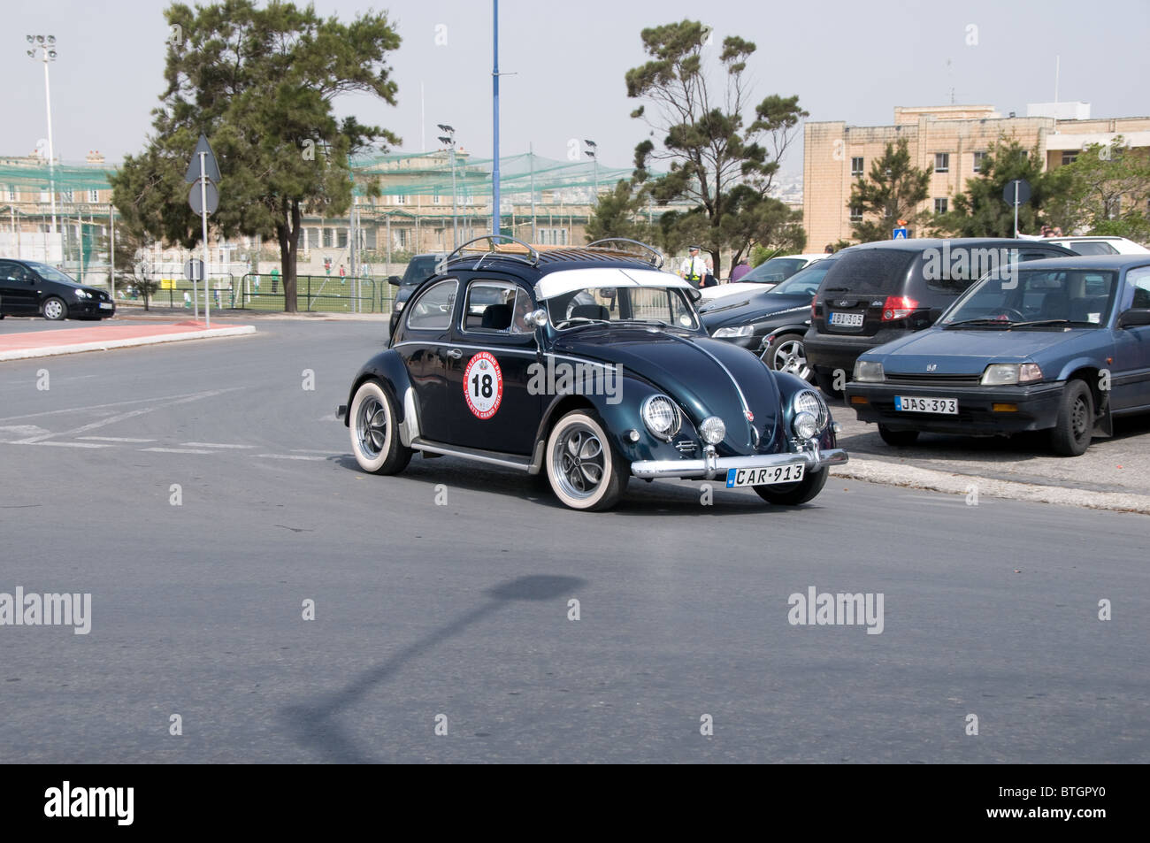 A Volkswagen Beetle takes part in the practice session for the Valletta Grand Prix for classic cars. Stock Photo