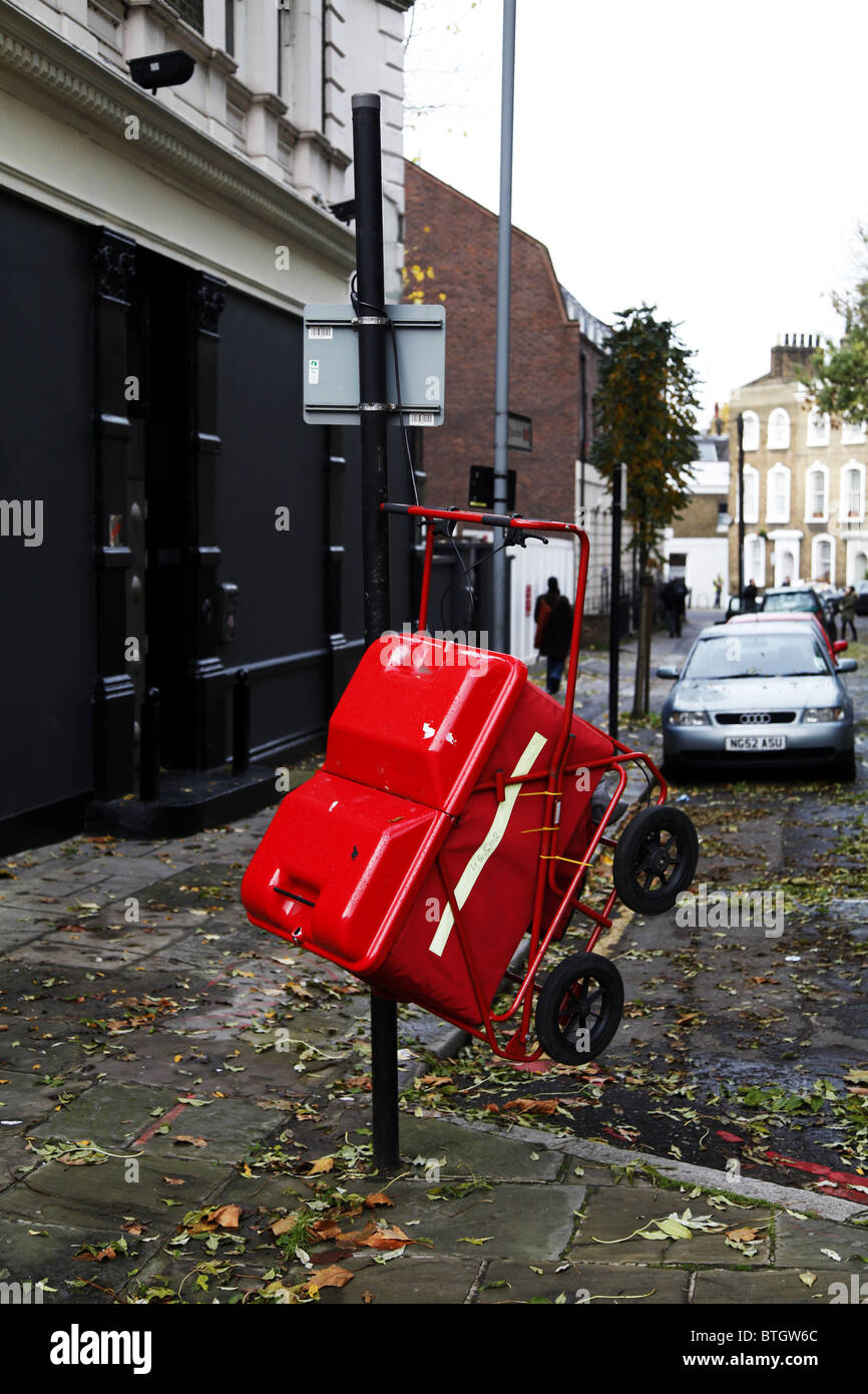 A postman trolley hanging. Camden. London - Stock Image