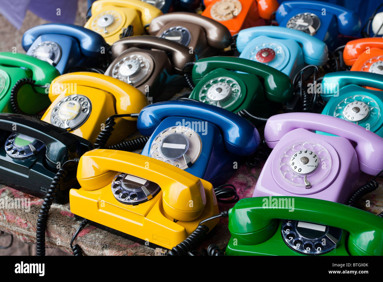 Colourful rotary dial telephones, Sao Paulo, Brazil - Stock Image