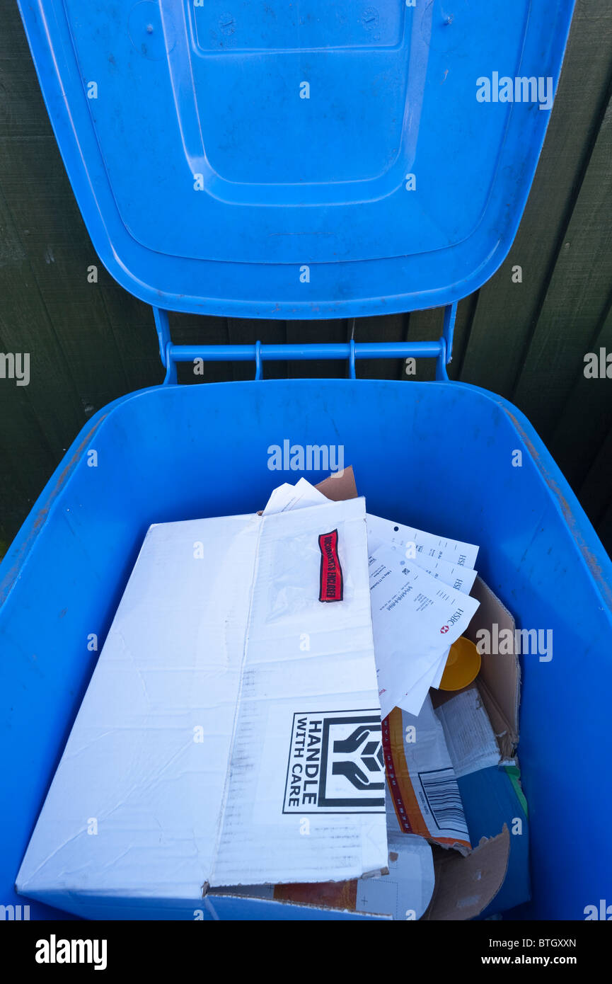 An open wheely bin showing bank statements etc. for identity fraud in the Uk - Stock Image
