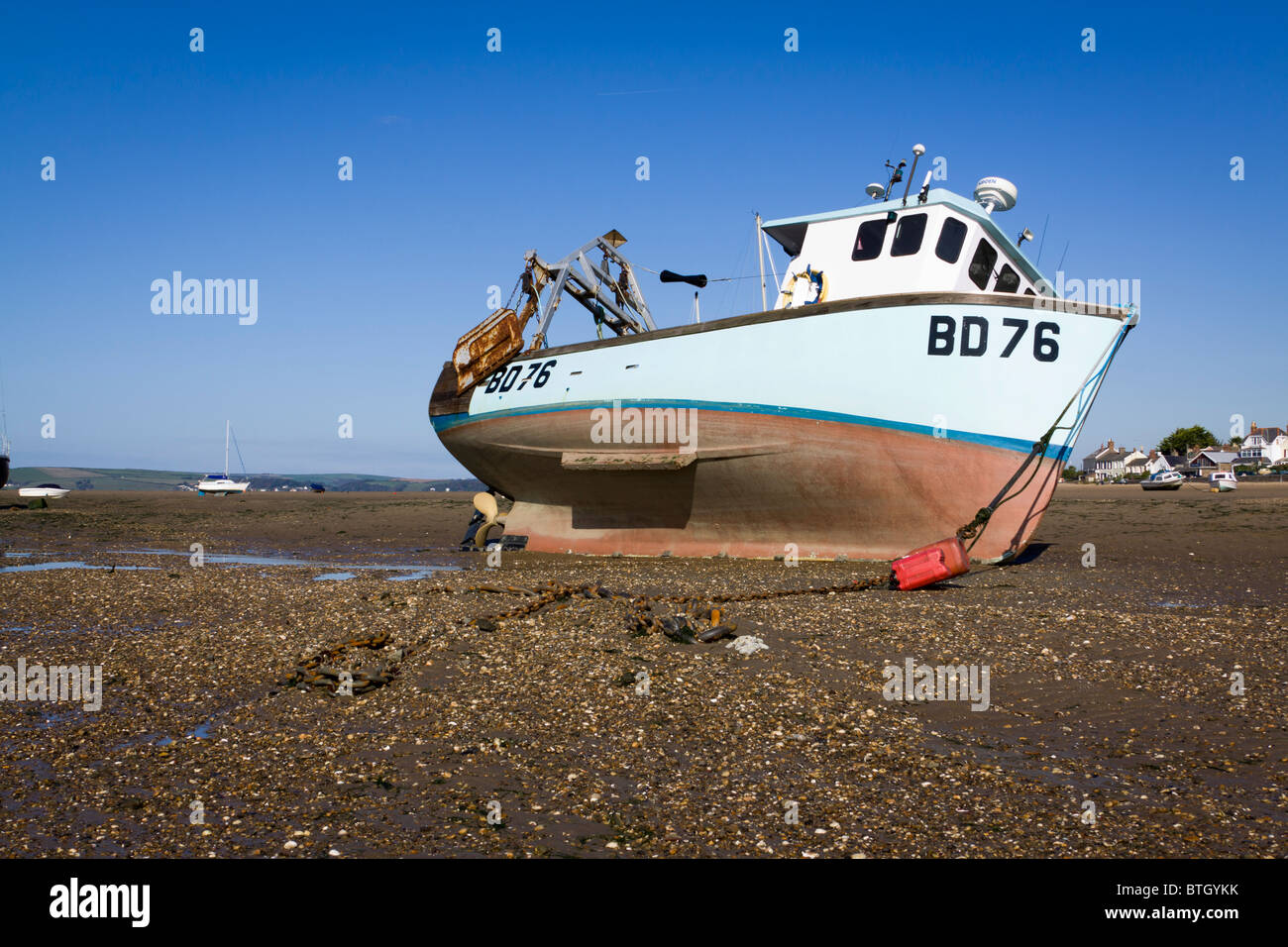 A commercial sea fishing boat on the beach tide out at Instow north Devon UK - Stock Image