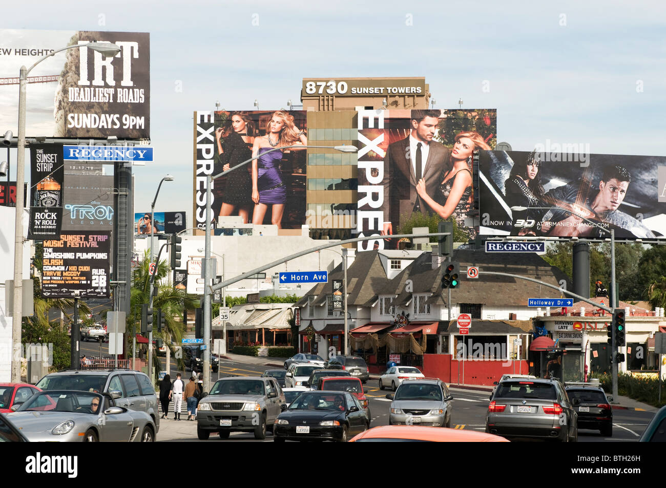 Giant billboards on Sunset Boulevard Hollywood Los Angeles Southern California - Stock Image