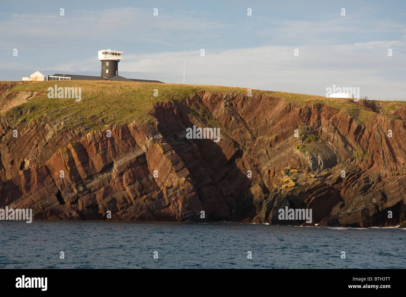 Old Red Sandstone folds in cliff, St. Anne's Head, Pembrokeshire, Wales, UK, Europe - Stock Image