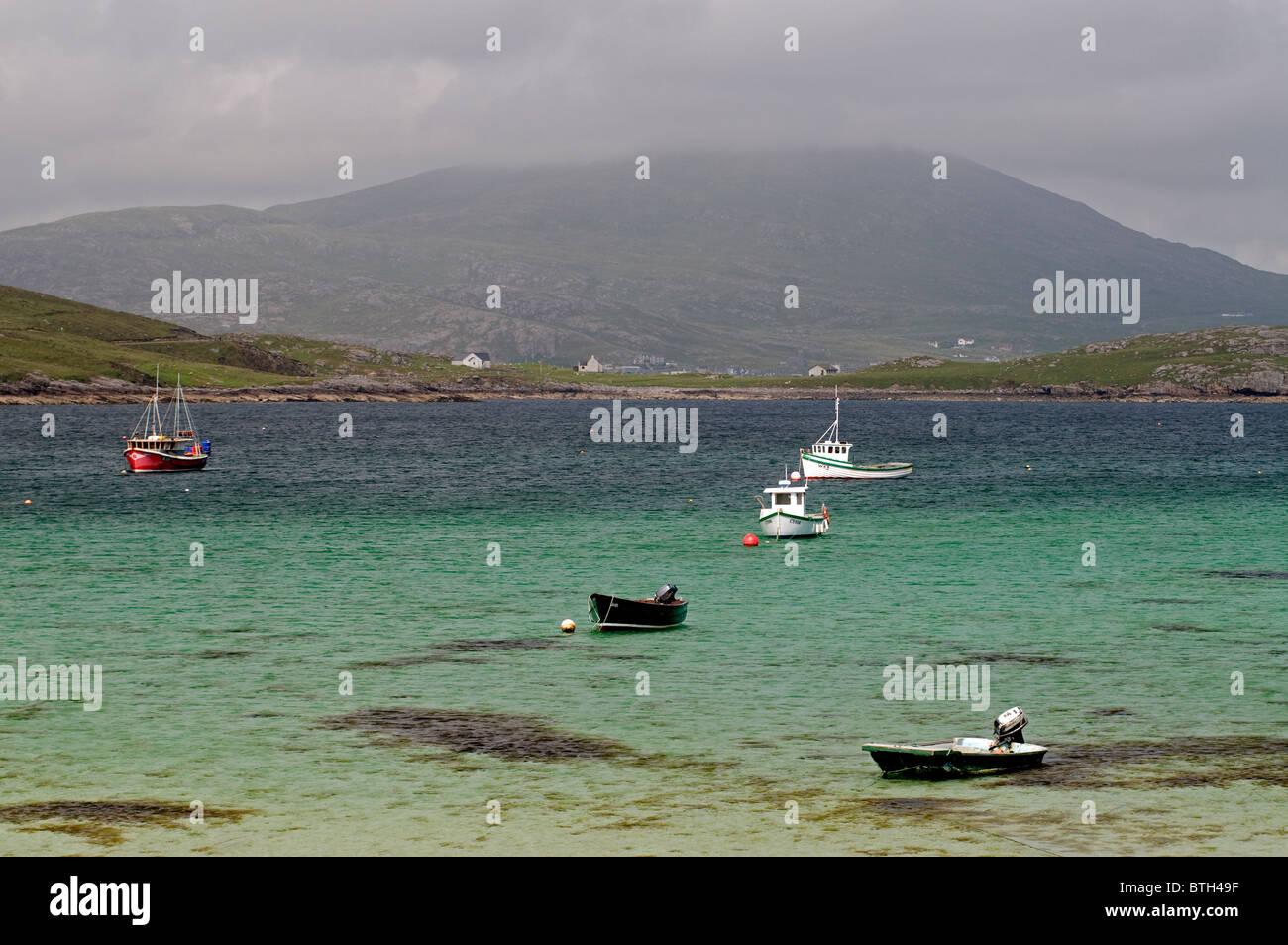 Local fishing boats anchored at Bagh Batarsaigh Township Beach moorings, Vatersay, Hebrides, Scotland. SCO 6572 - Stock Image