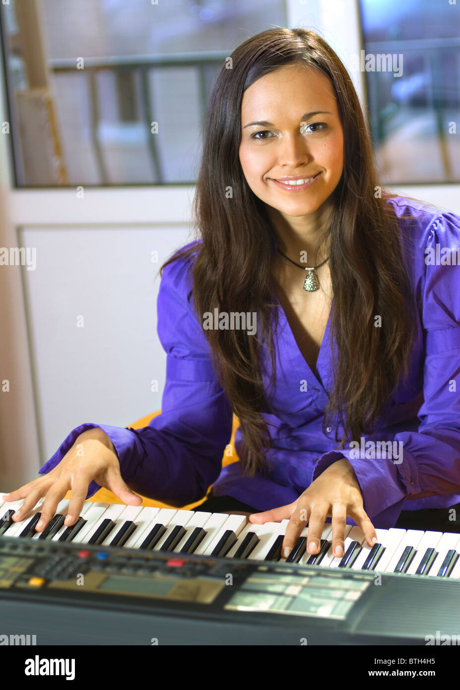 happy young pianist with sequencer on a studio - Stock Image