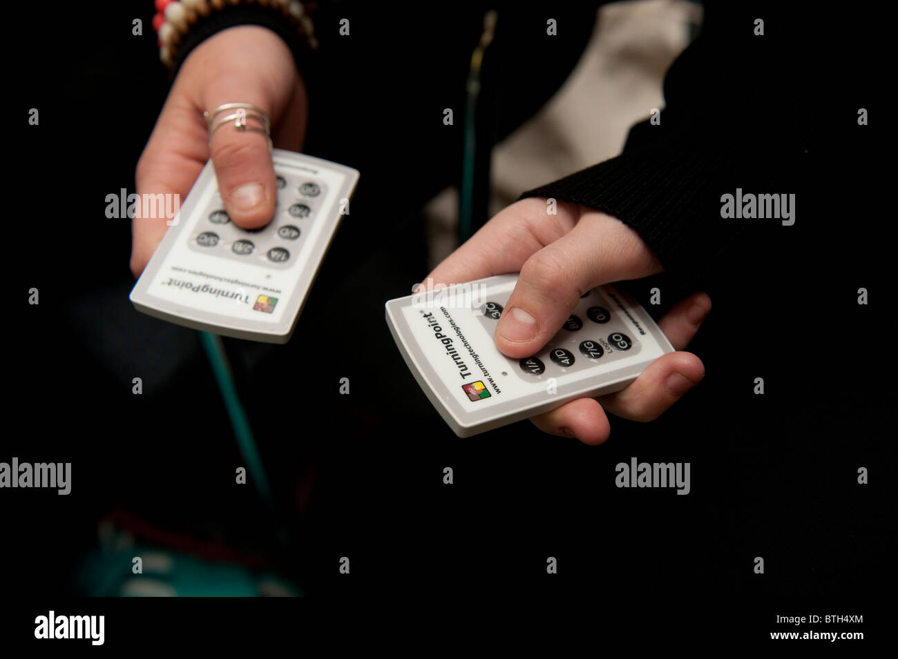 Using TurningPoint interactive response electronic infrared IR voting handsets, UK - Stock Image
