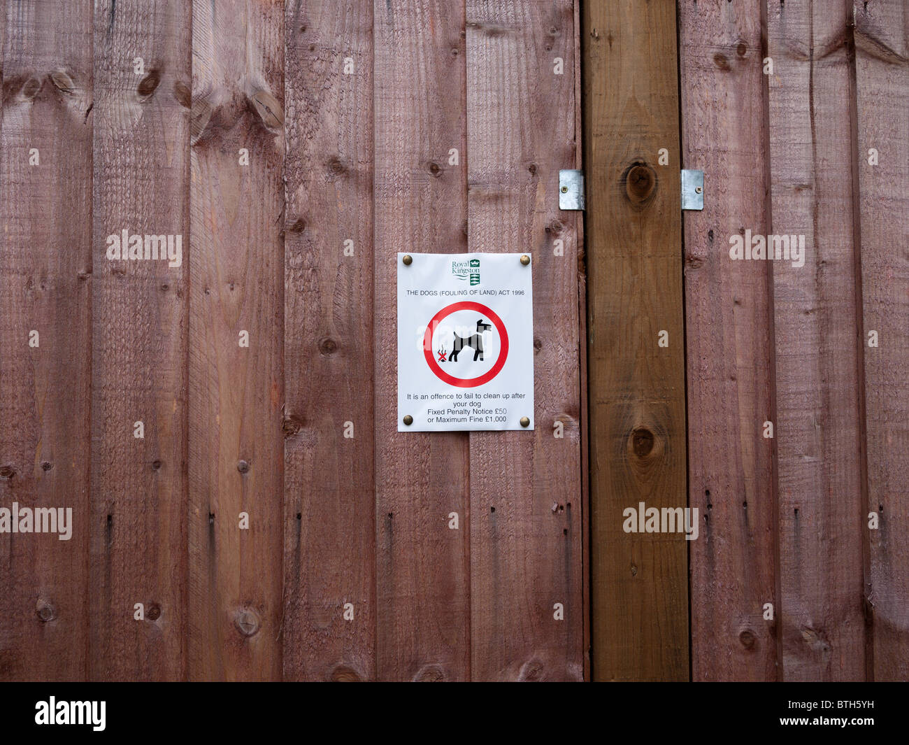 notice warning owners not to let their digs foul the land. - Stock Image