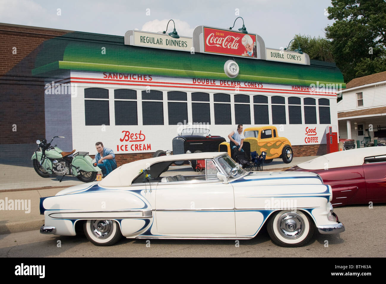 Auto 1954 Chevrolet At Franklin Ohio Usa Car Show Building With Painted Diner Mural And Coca Cola Sign