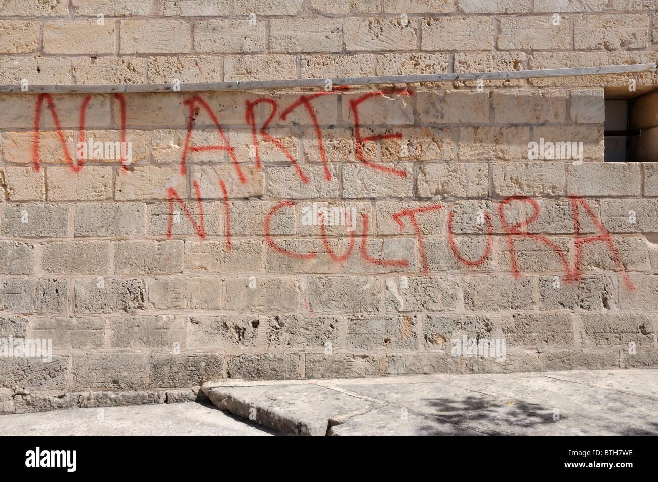 Graffiti protest on the walls of the bull ring, Alcudia, Majorca - Stock Image