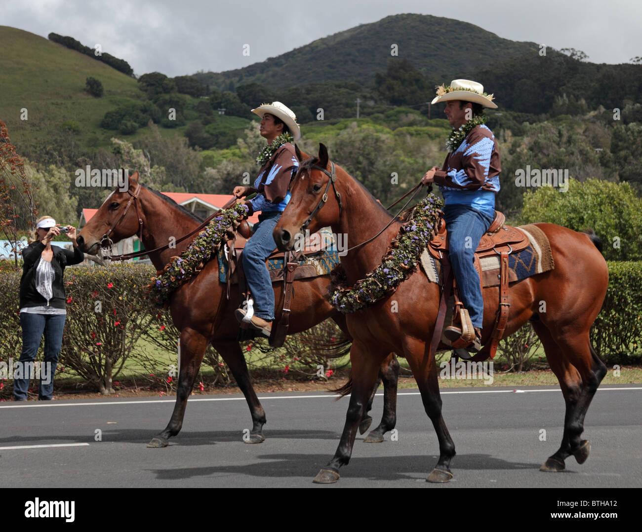 ee788e3e5 Men ride in the 35th annual Waimea Paniolo Parade on the Big Island of  Hawaii -