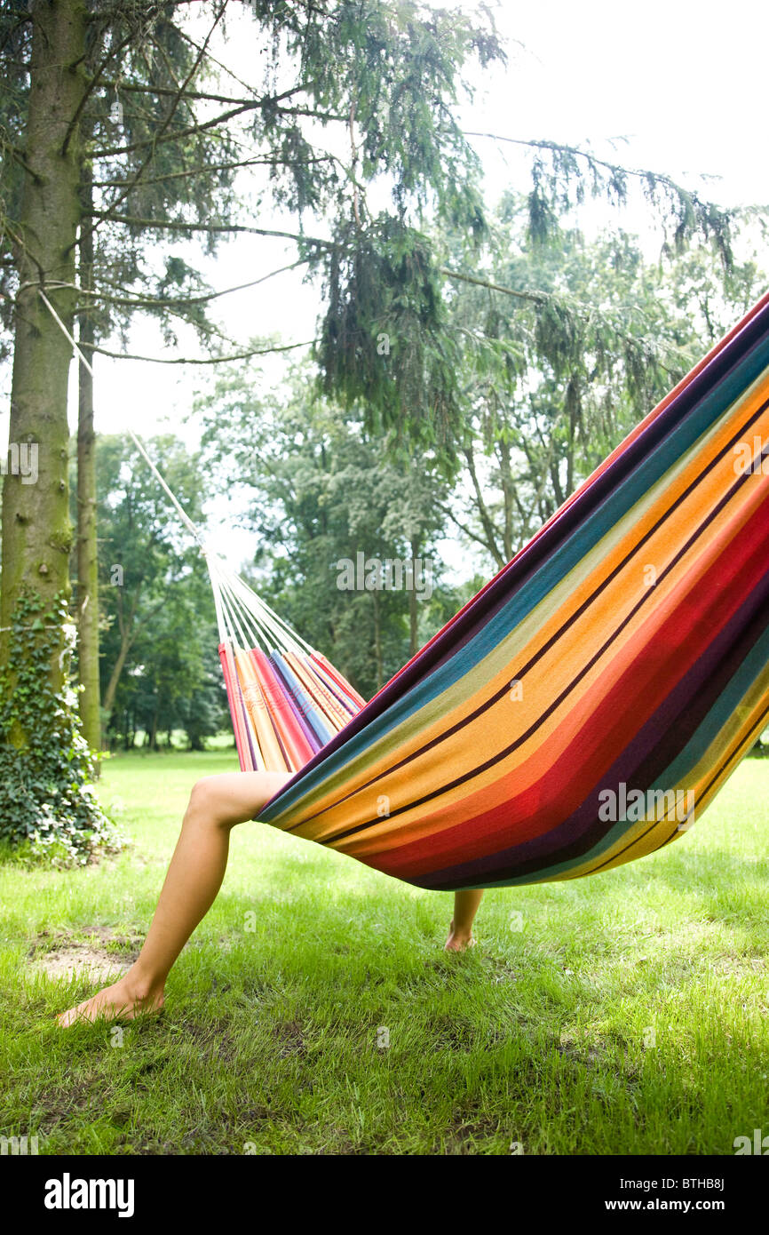 young woman relaxing on hammock - Stock Image