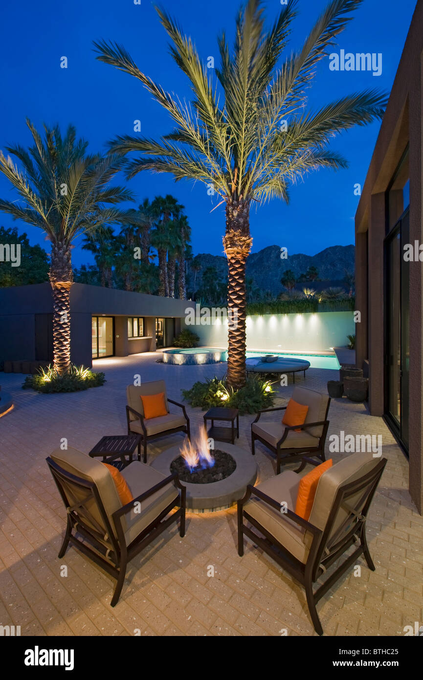 Etonnant Lit Palm Trees At Firepit With Chairs On Terrace Of California Home   Stock  Image