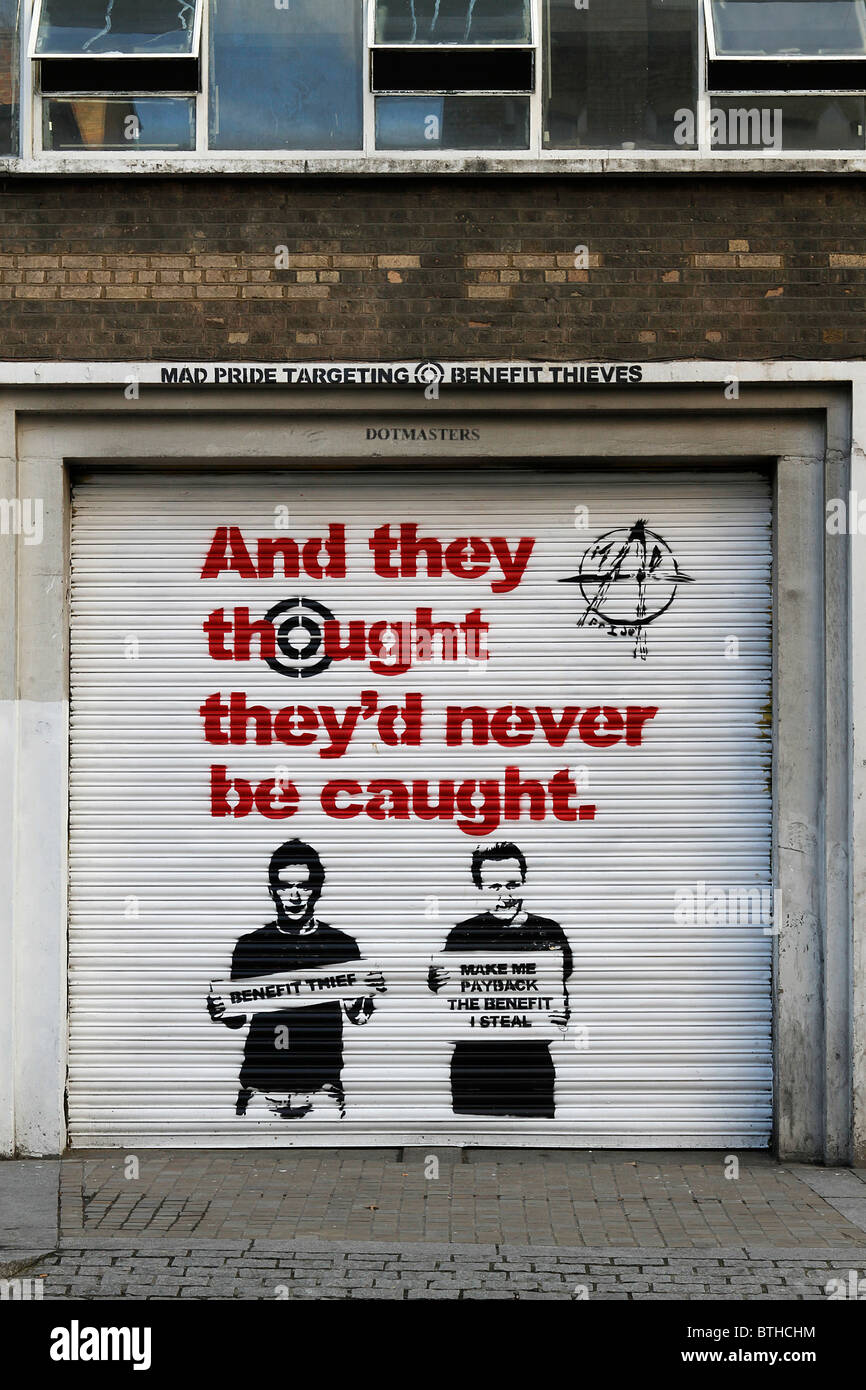 stencil graffiti of benefit fraud advertising campaign, and they thought they'd never be caught. David Cameron - Stock Image